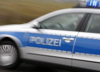 Polizist*innen auf Einsatzfahrt. Foto: Polizei